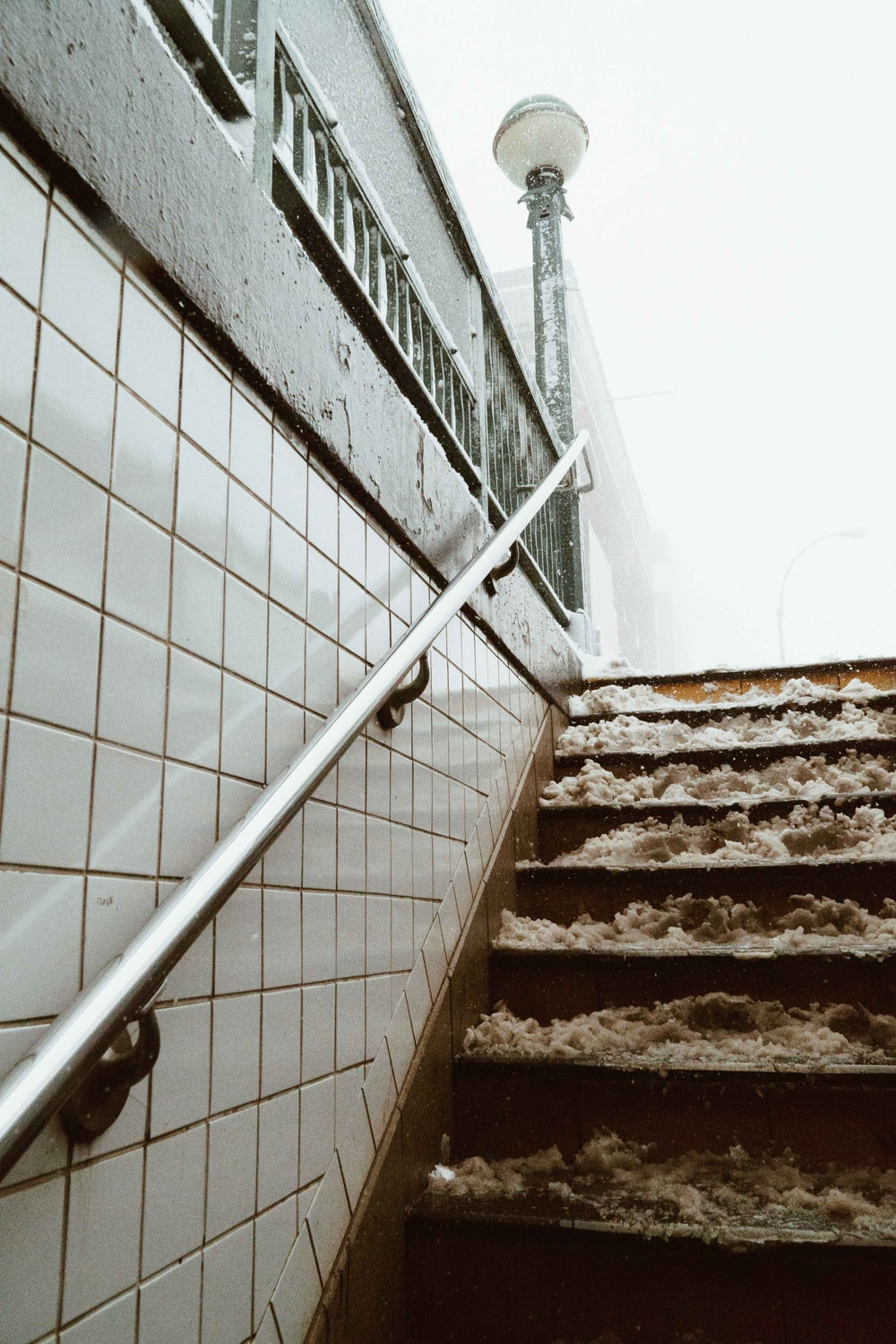 wooden stairs with metal handle