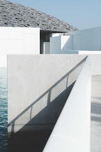 concrete pavement near body of water