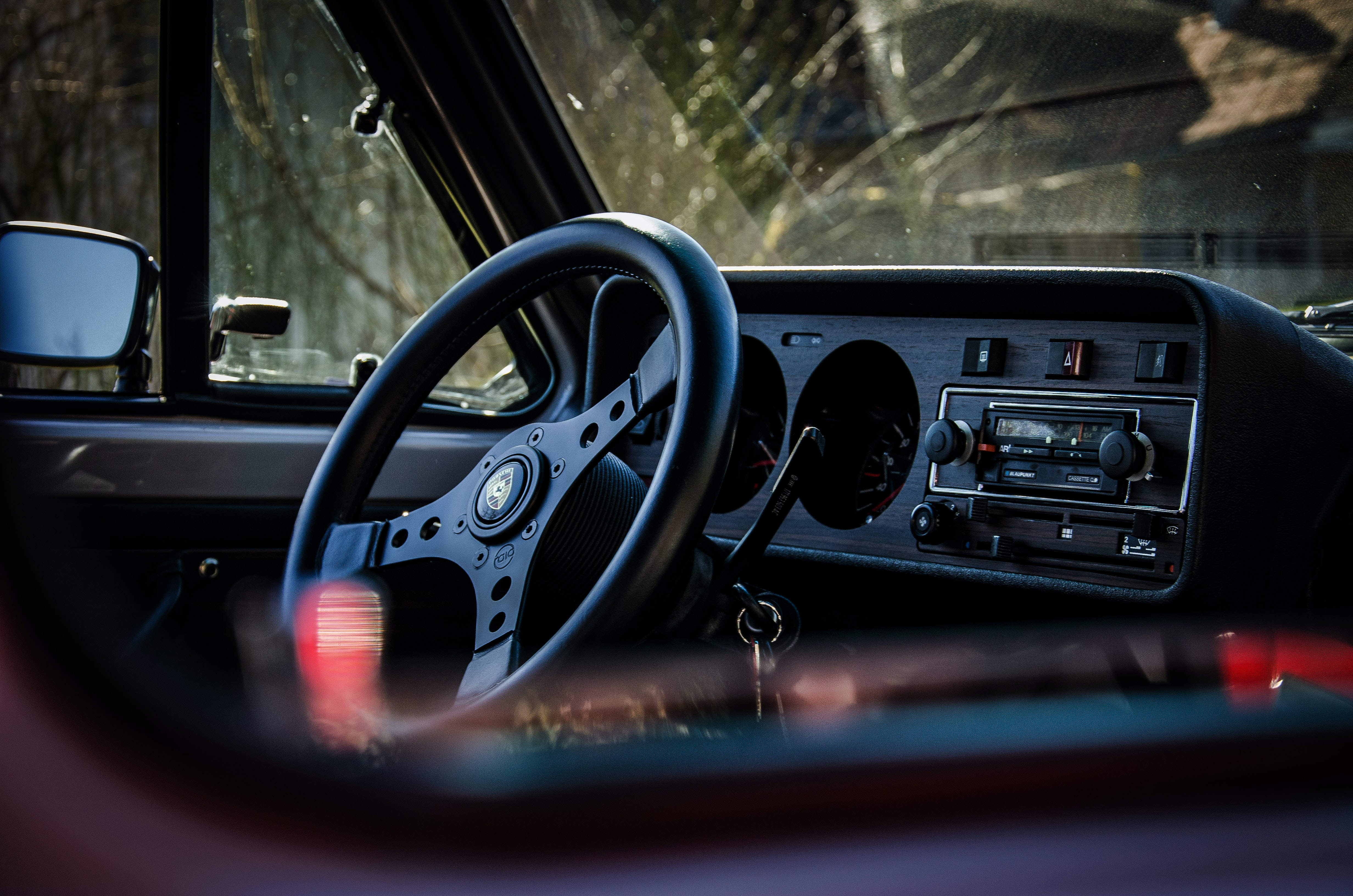 selective focus photography of vehicle steering