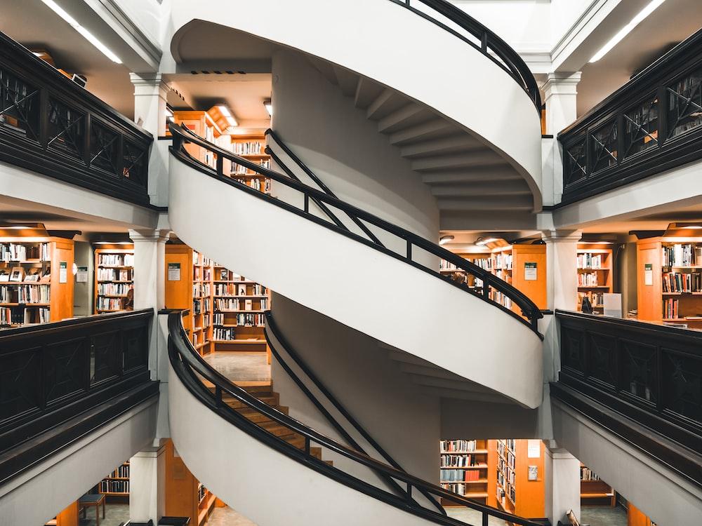 white concrete spiral staircase