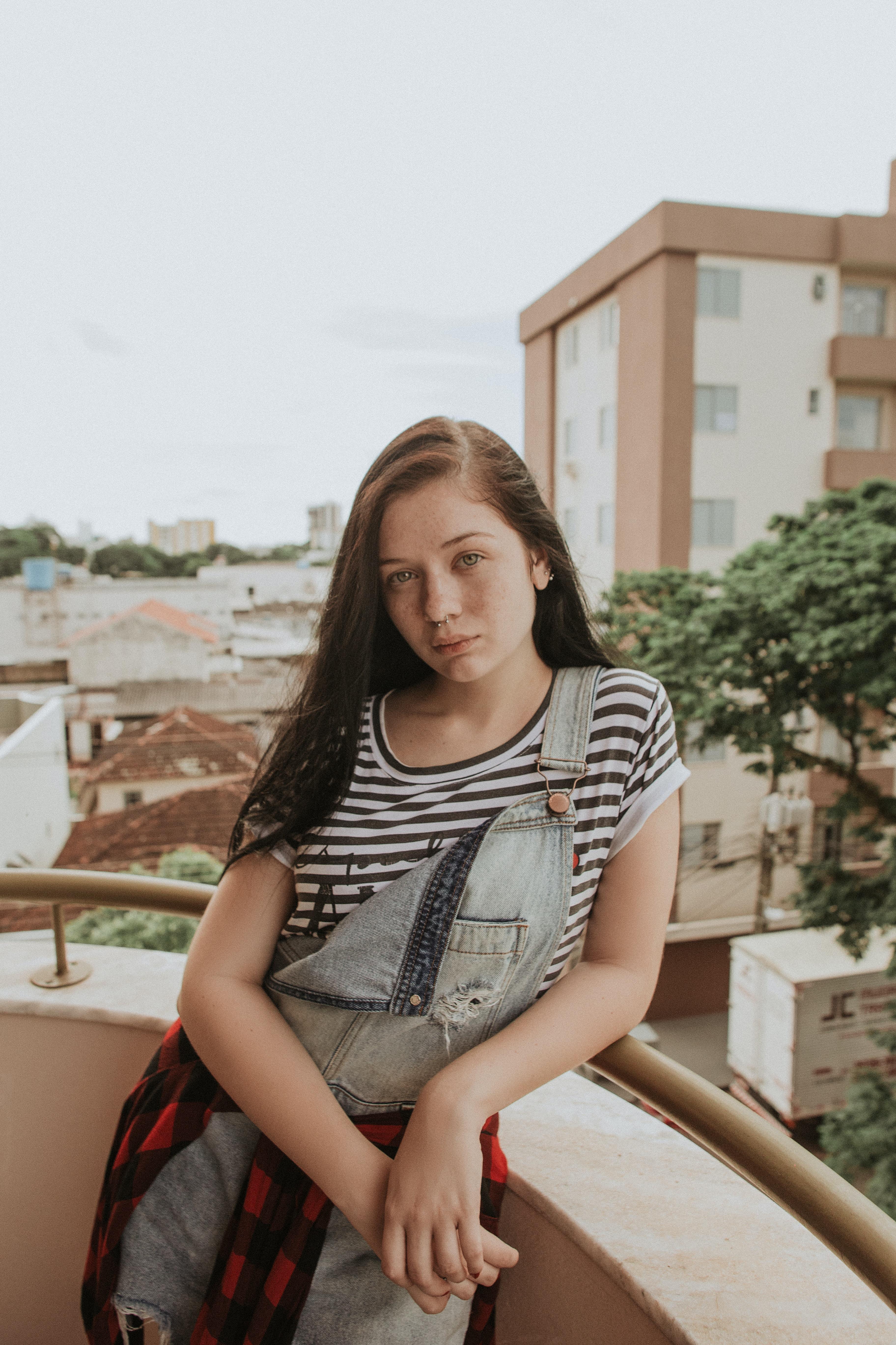 woman leaning on terrace