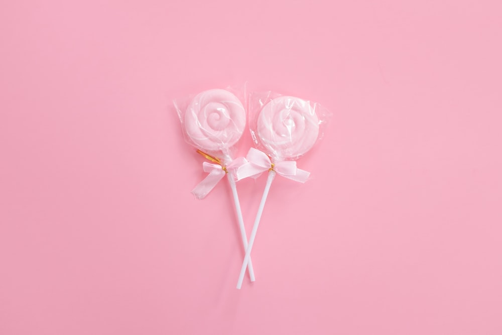 two pink candyes