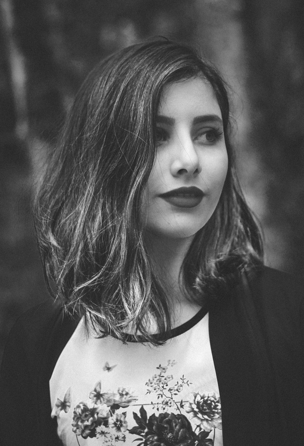 grayscale photography of woman wearing cardigan