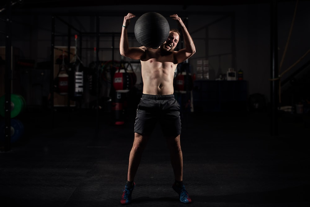 man carrying stability ball