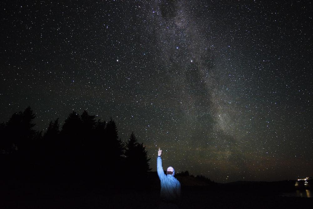 man pointing on stars