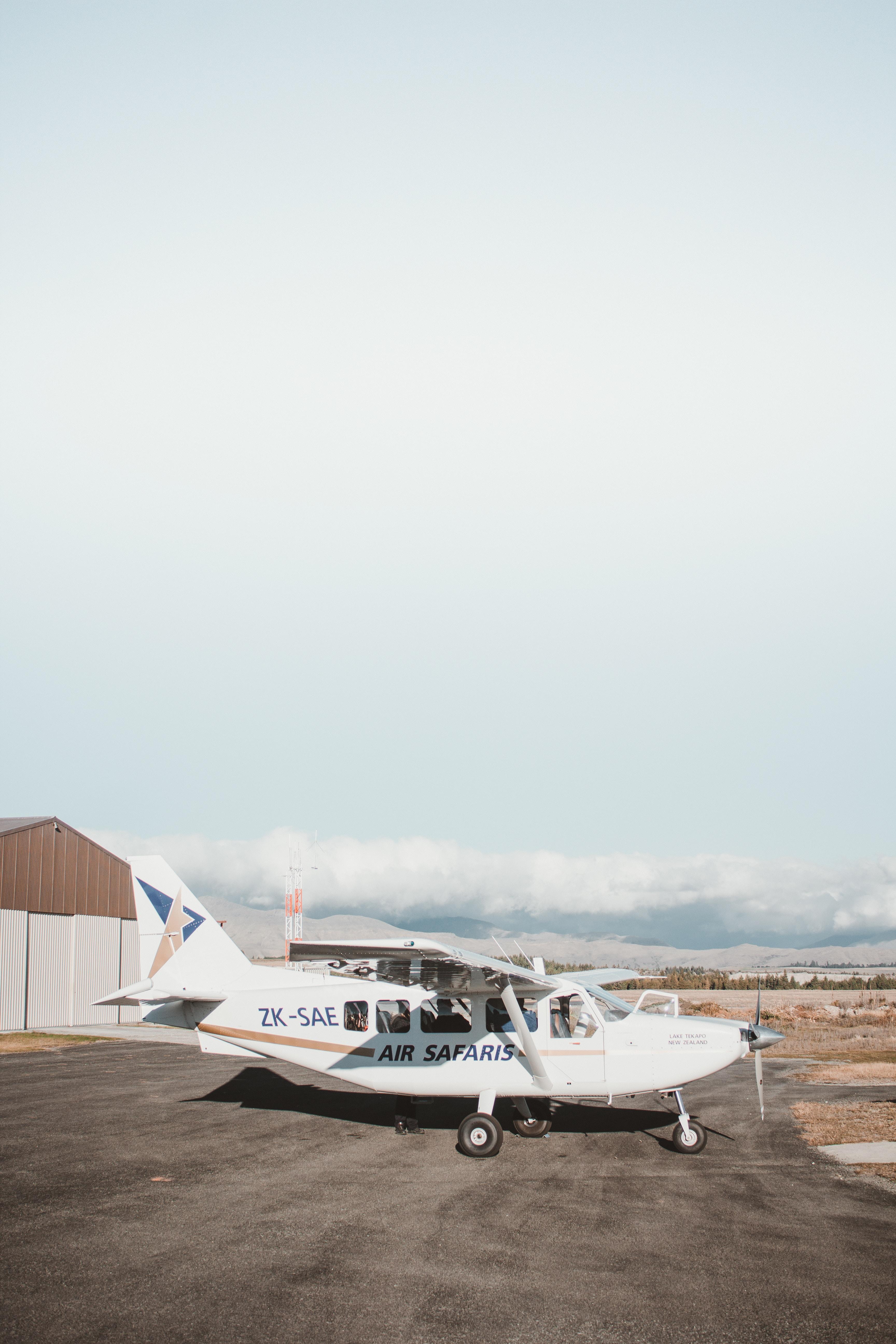 white Air Safaris plane at the airport