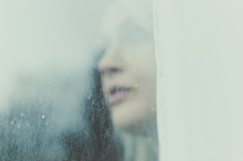 woman's face against glass window