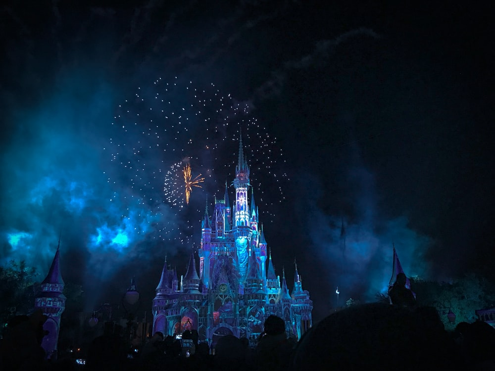 crystal castle with fireworks at night