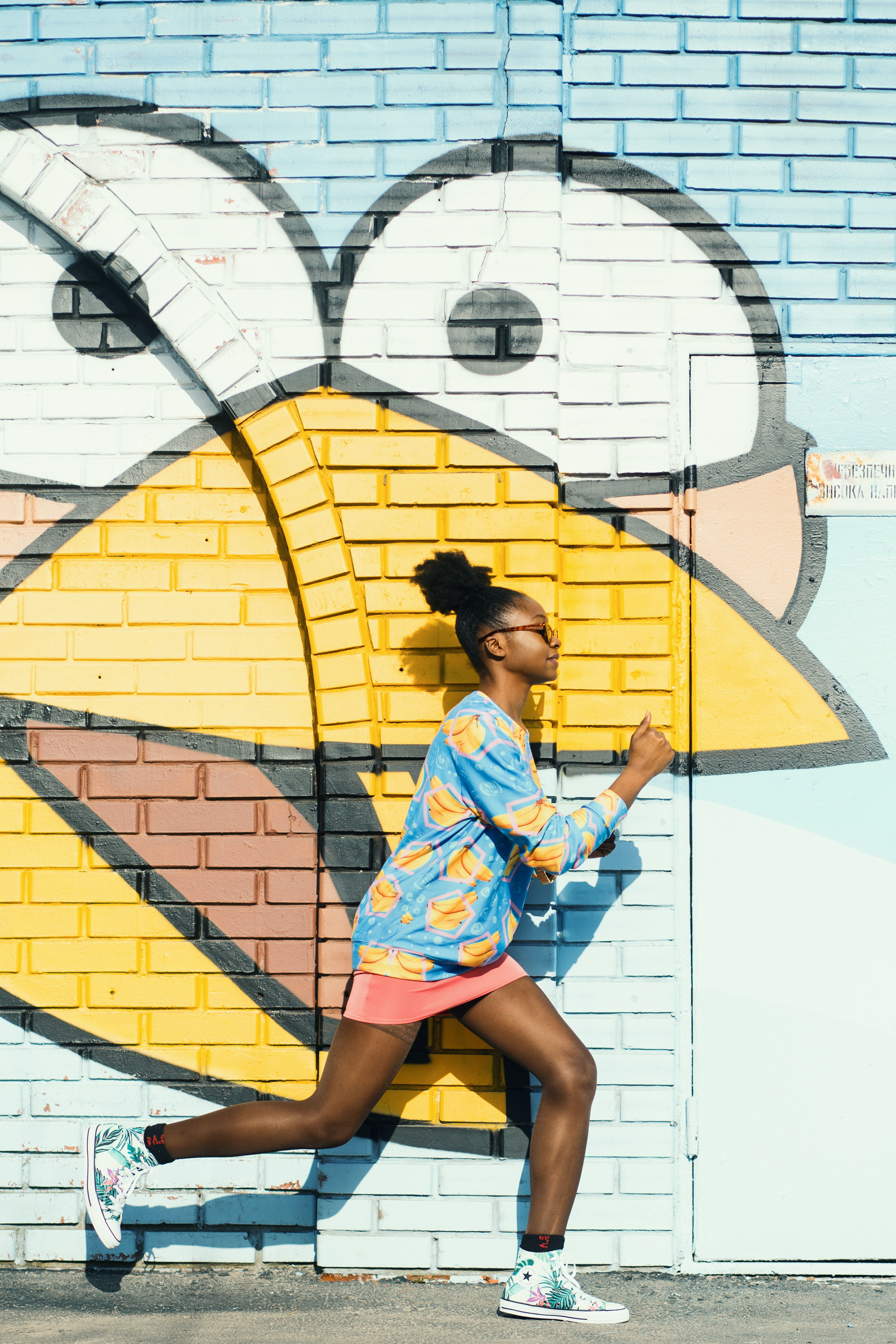 woman running on painted wall