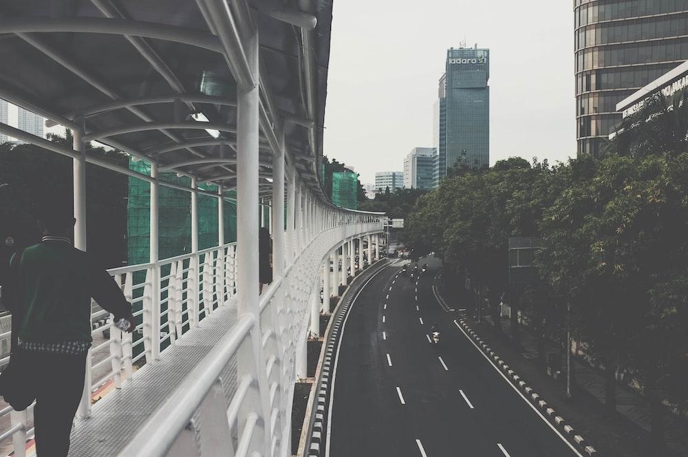 man walking on bridge