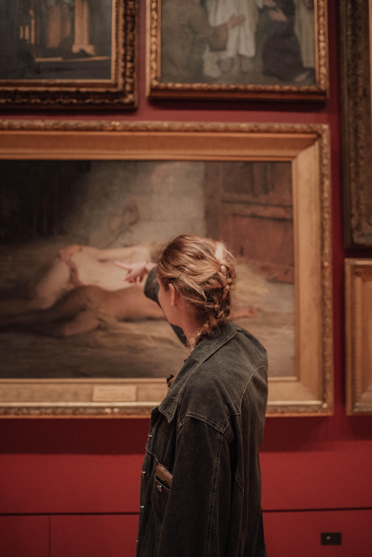 woman walking in museum