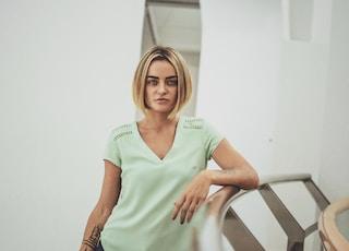 woman standing near stair rail inside room