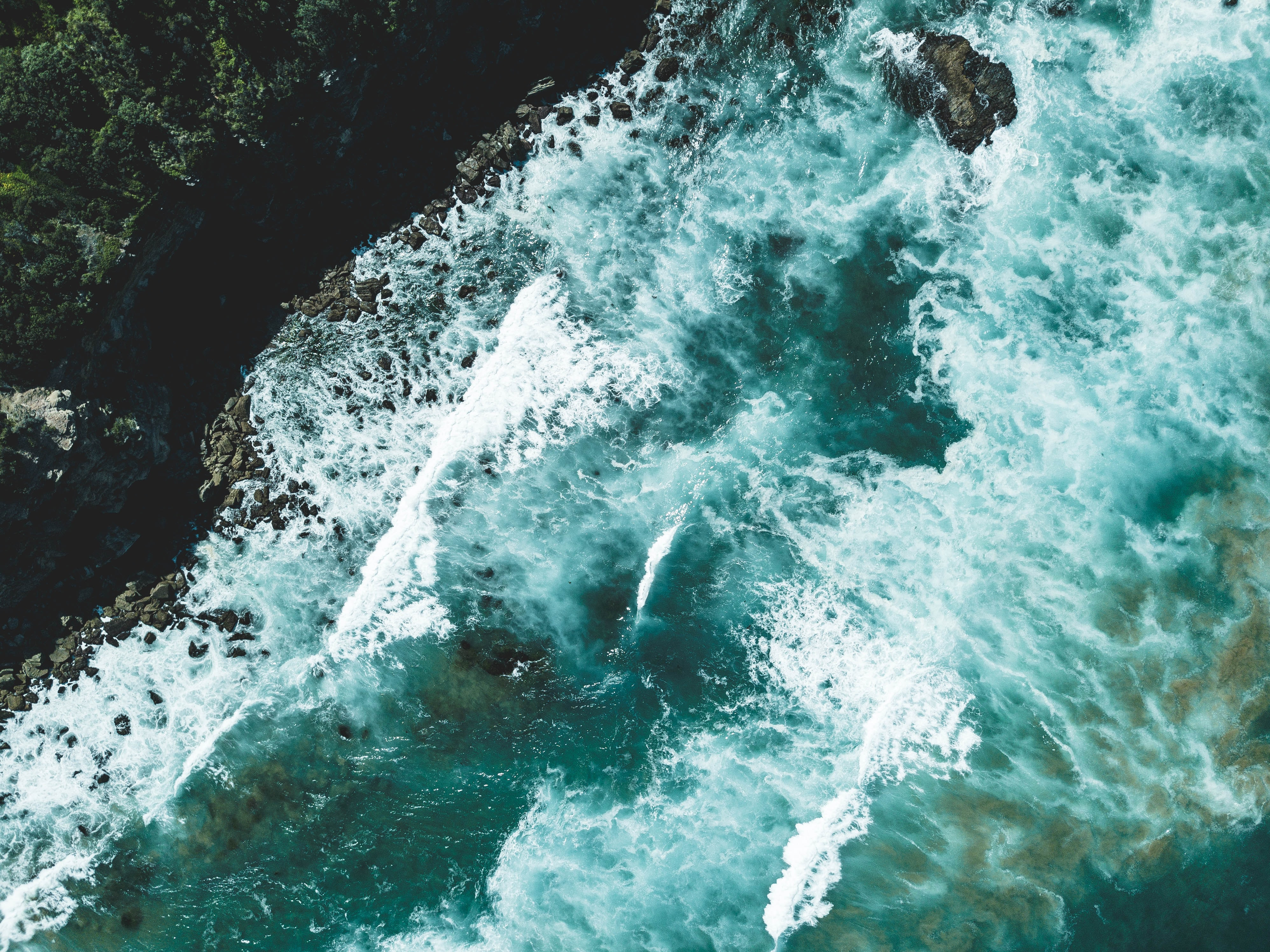 aerial view photography of ocean waves during daytime