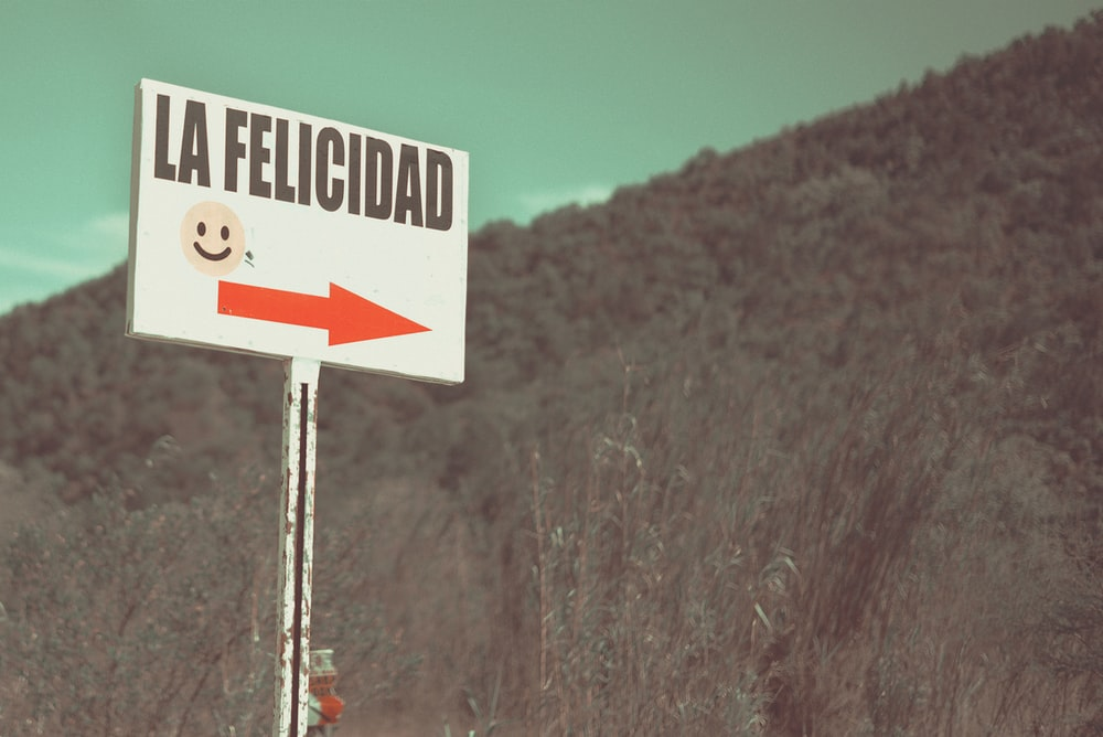 photo of white and black la felicidad signage