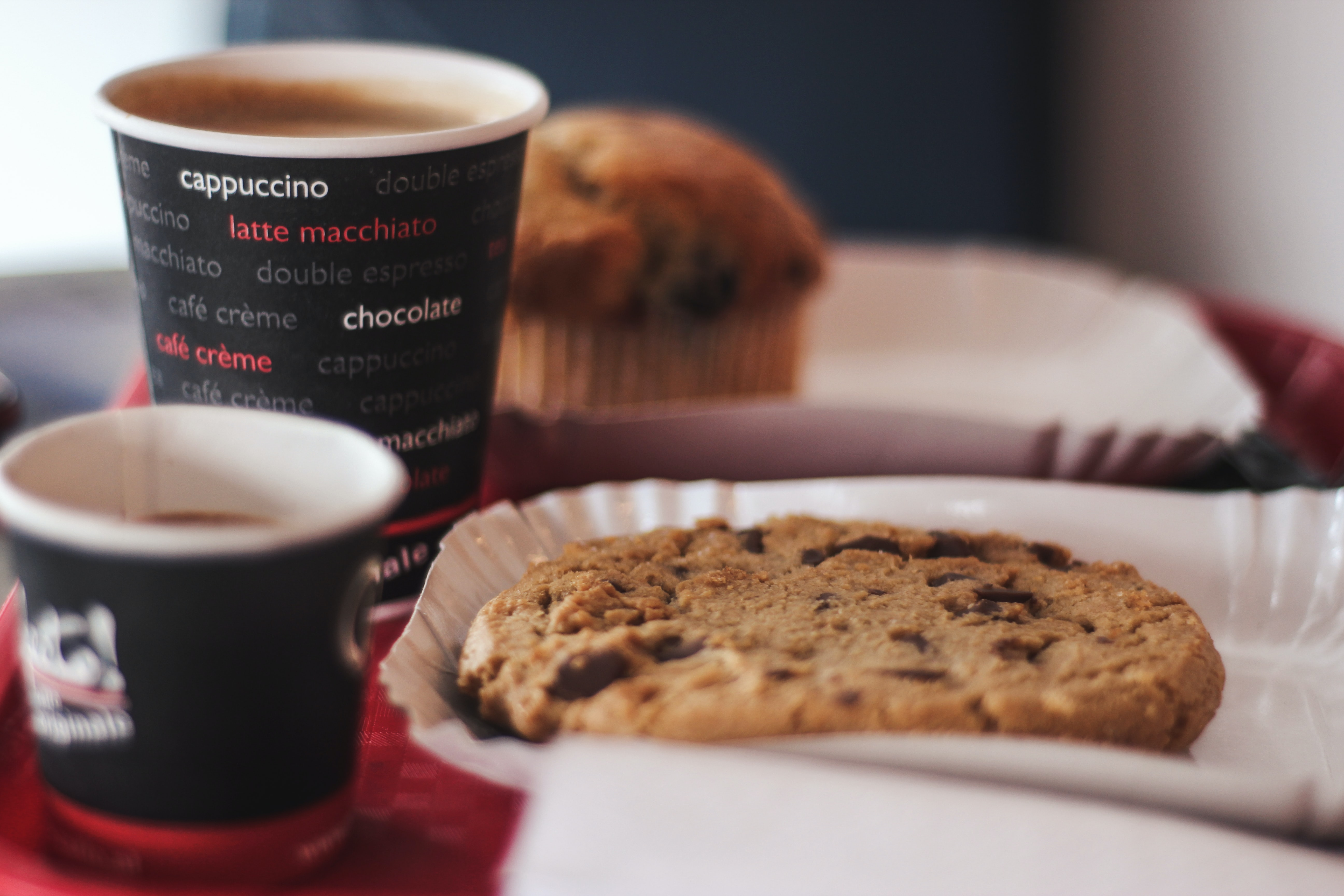 shallow focus photography of cookie and cup of coffee