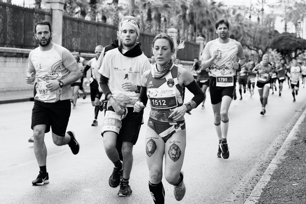 grayscale photography of jogging people