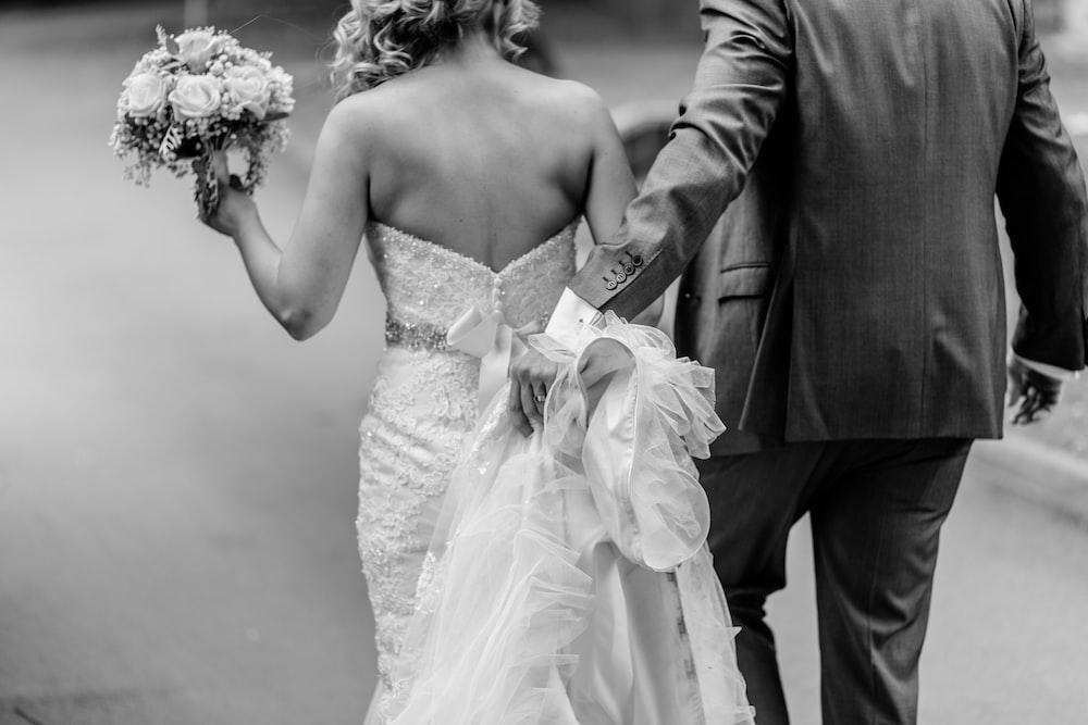 grayscale photography of wedding couple