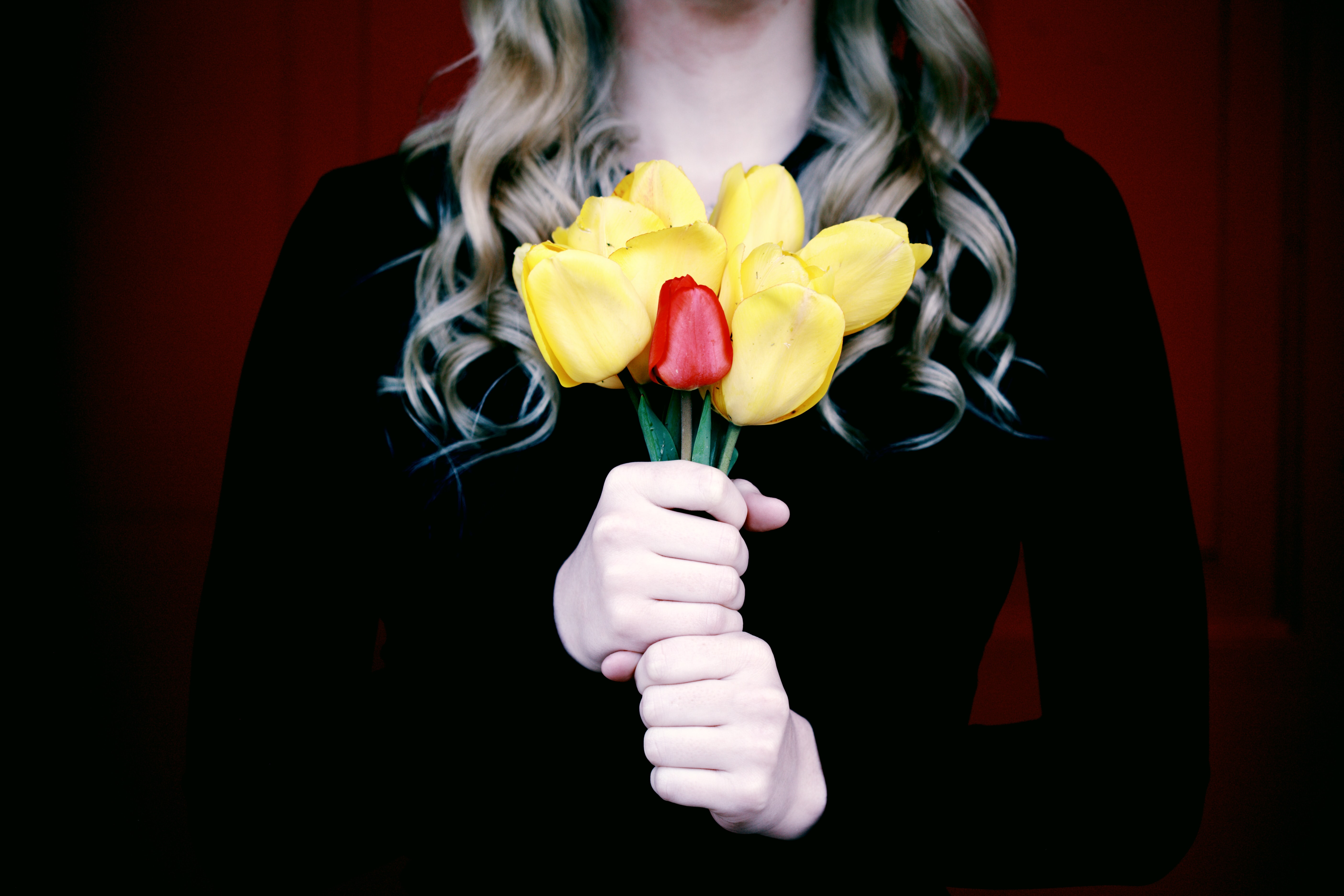 woman holding artificial flowers