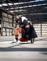 man kneeling on ground
