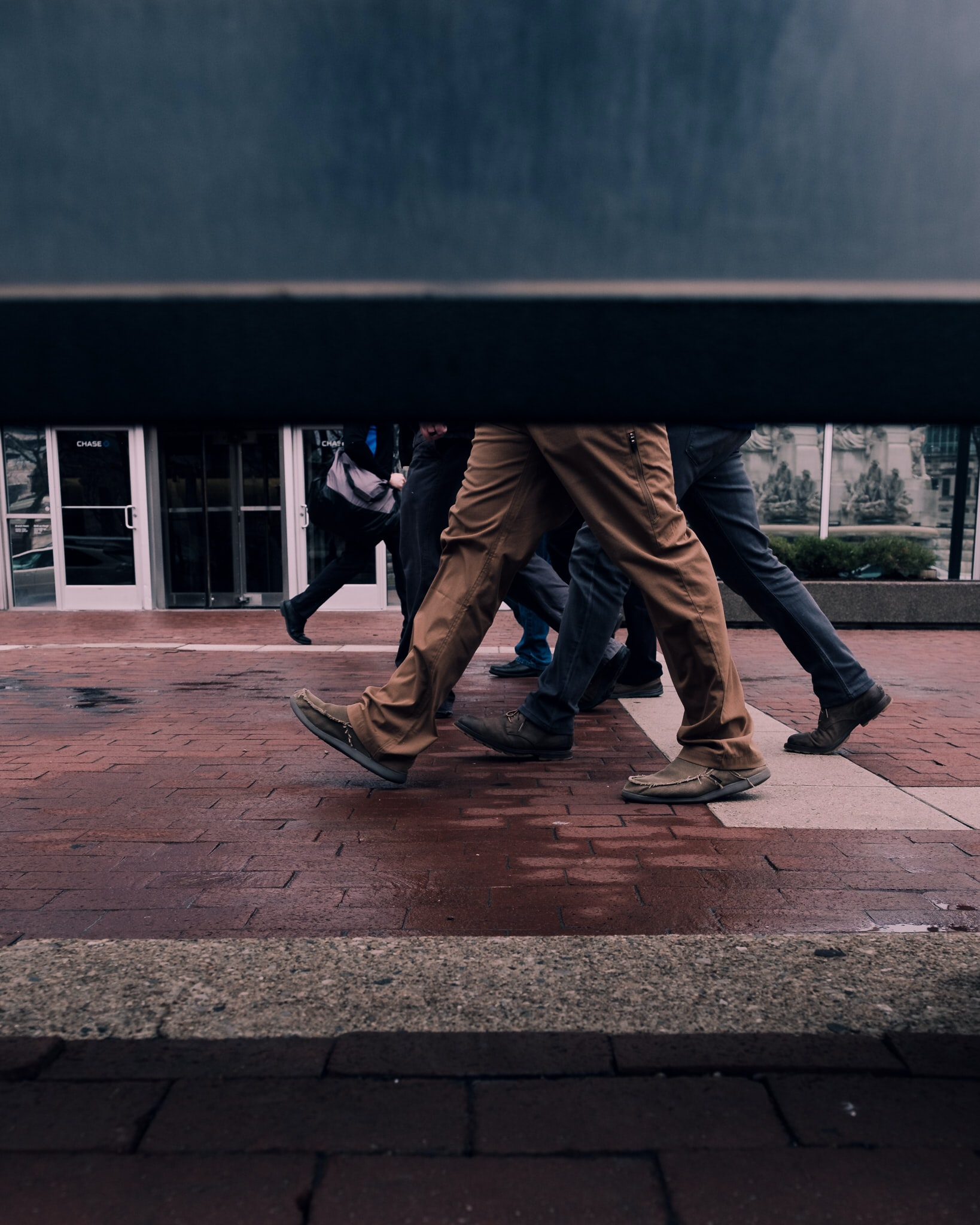 people walking at the concrete brick