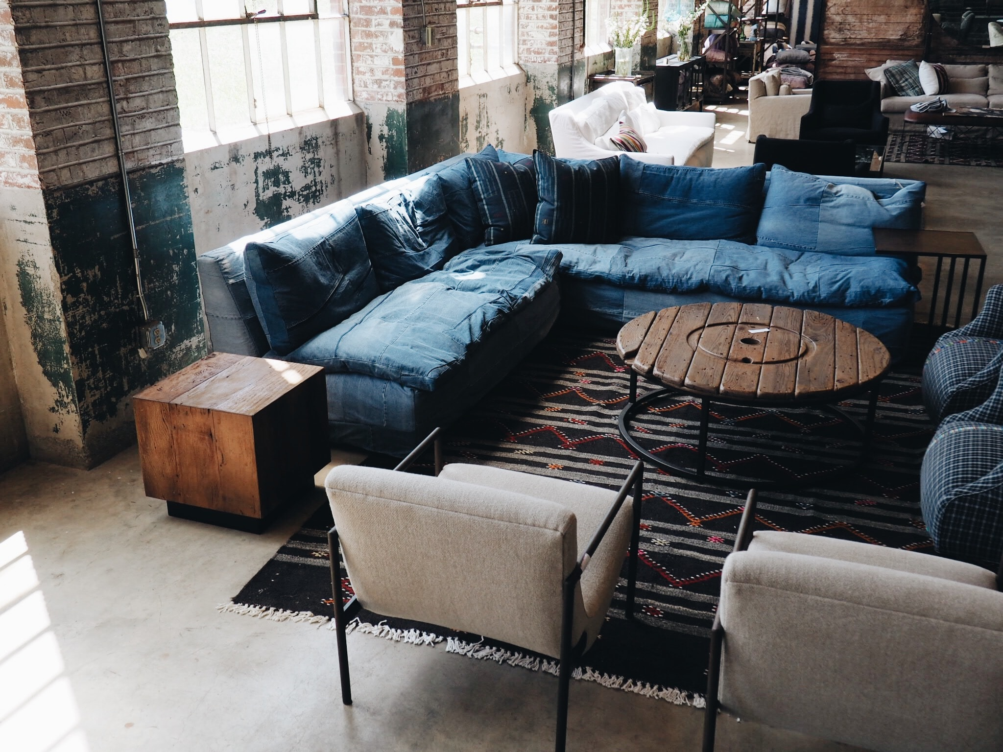 blue couch and white armchairs