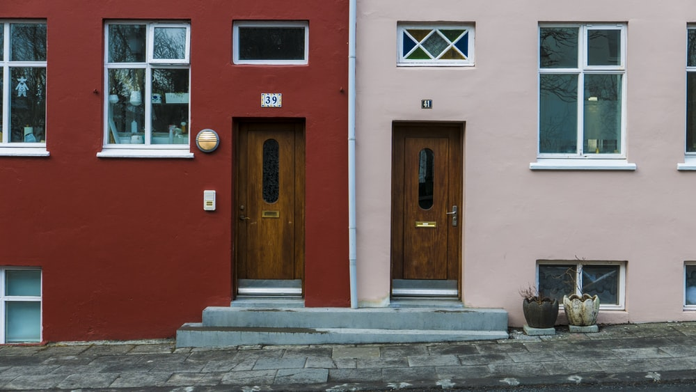 red and pink houses with brown wooden doors