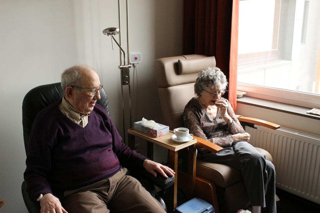 Elderly couple sitting together