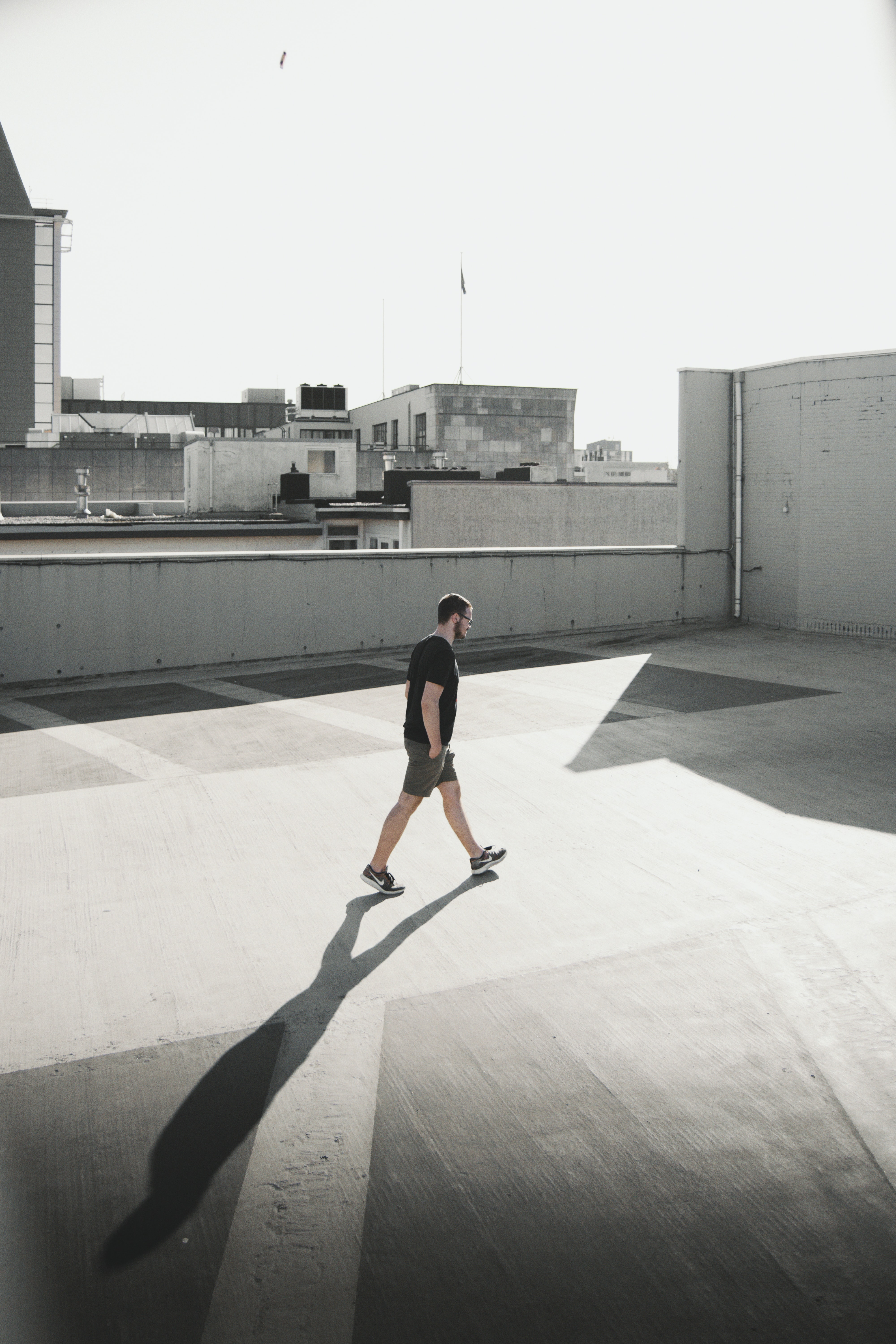 man walking on building roof top