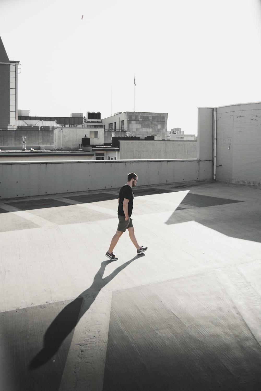 man walking on building roof top