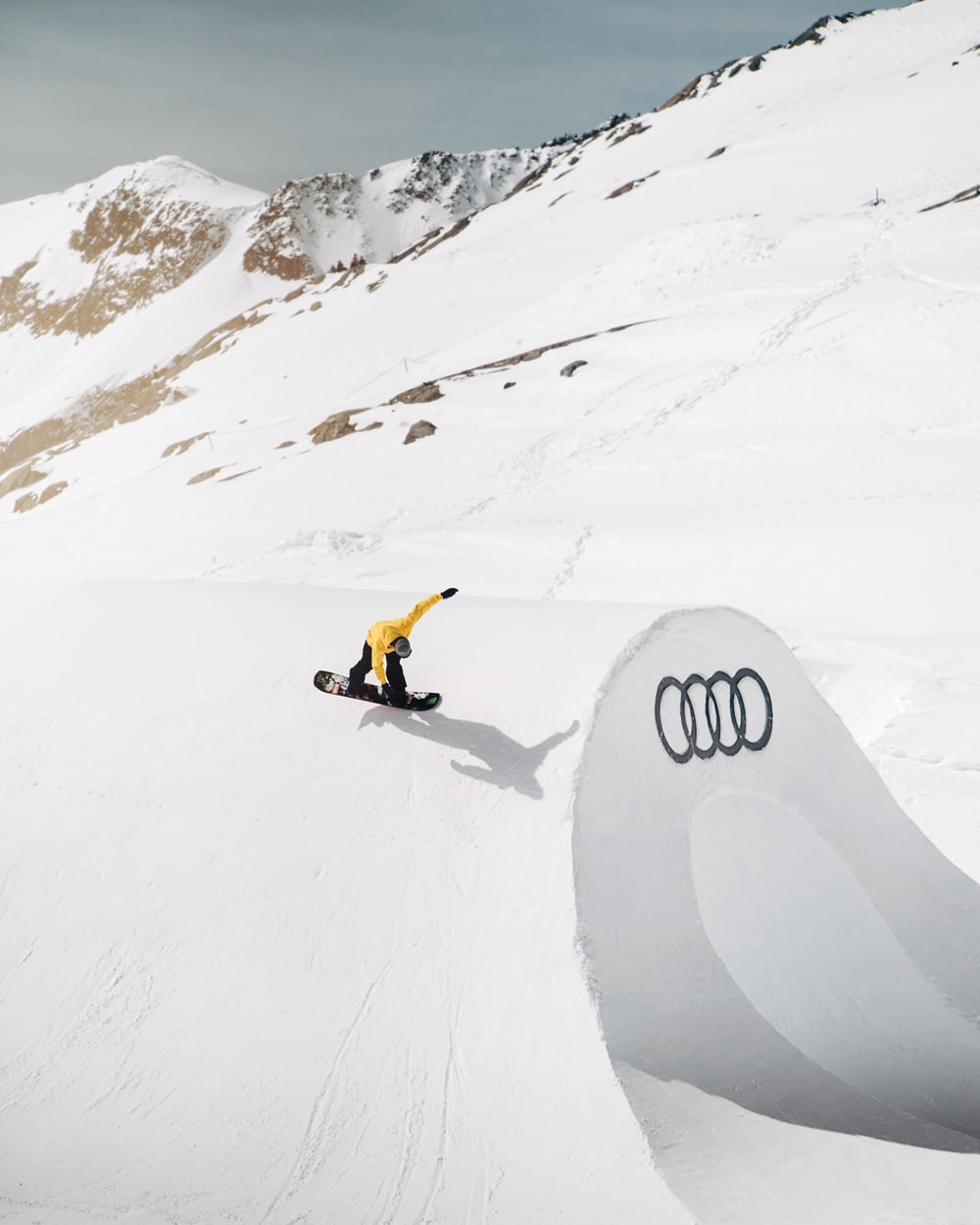 person snowboarding using black snowboard