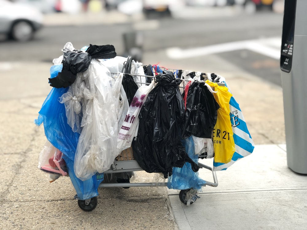 assorted=color plastic pack in shopping cart on street