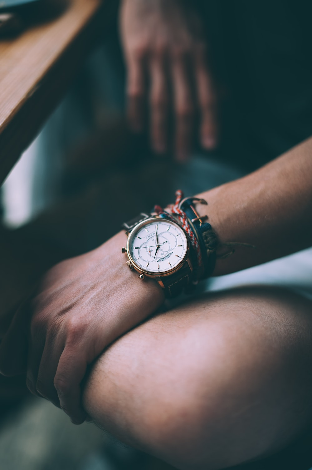 round silver-colored analog watch