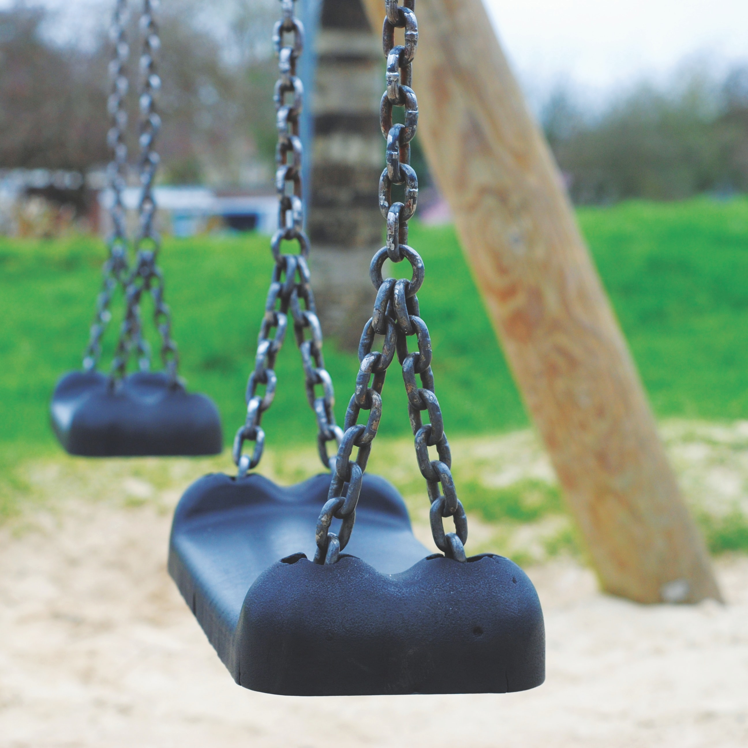 shallow focus photography of swing