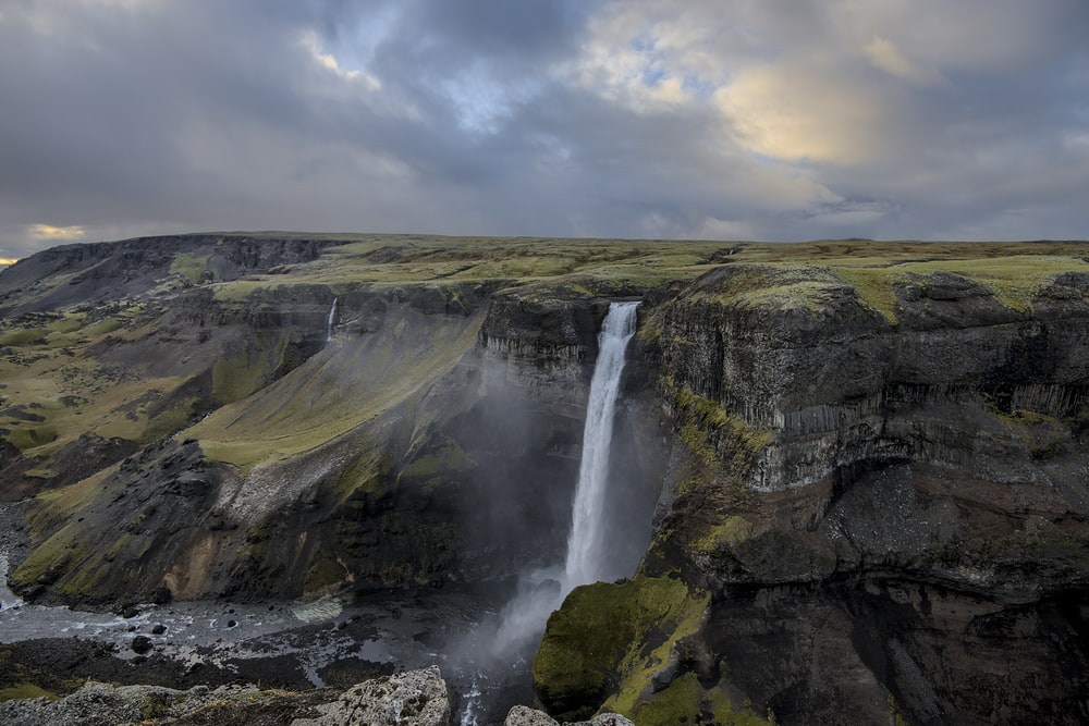 time lapse photography of mountain falls