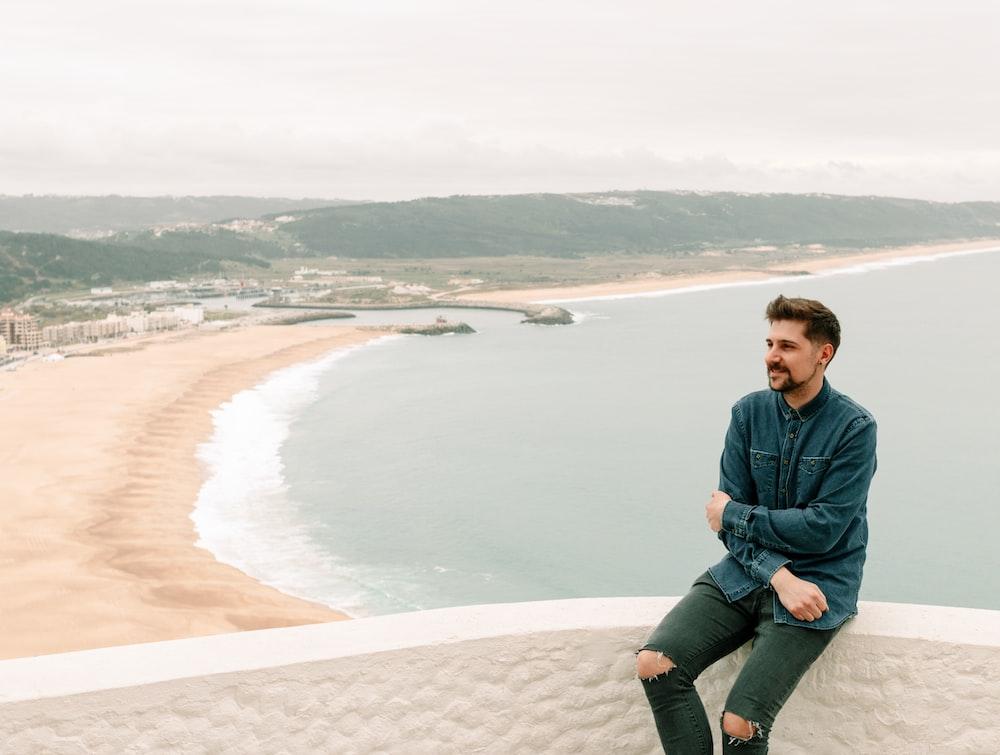 man sitting on bridge