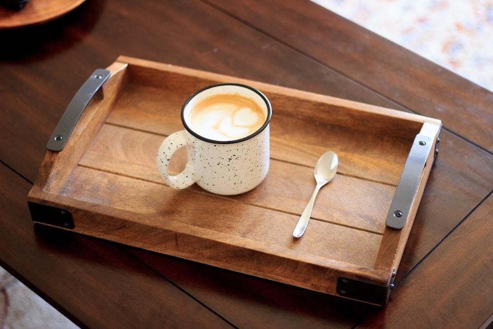 white ceramic mug on brown wooden serving tray