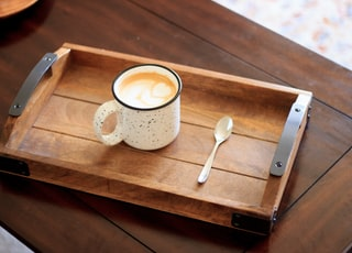 white ceramic mug on brown wooden serving tray