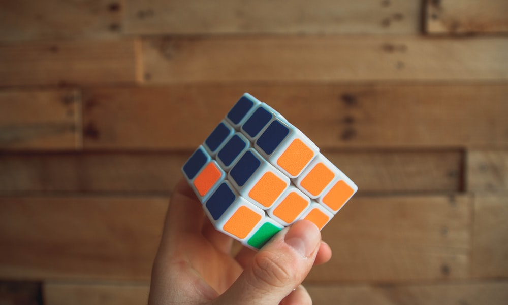 person holding 3x3 Rubik's Cube