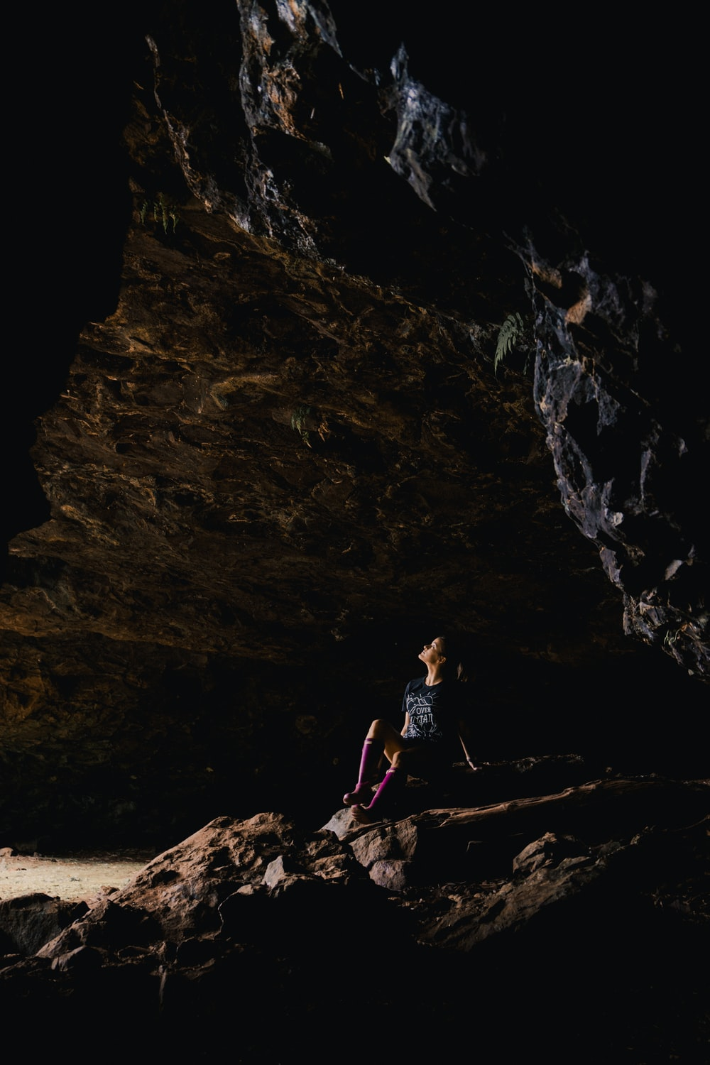 woman sitting inside cave