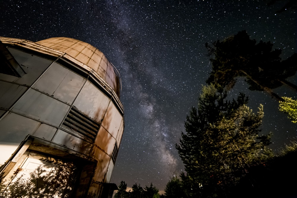 low angle photography of building under starry night