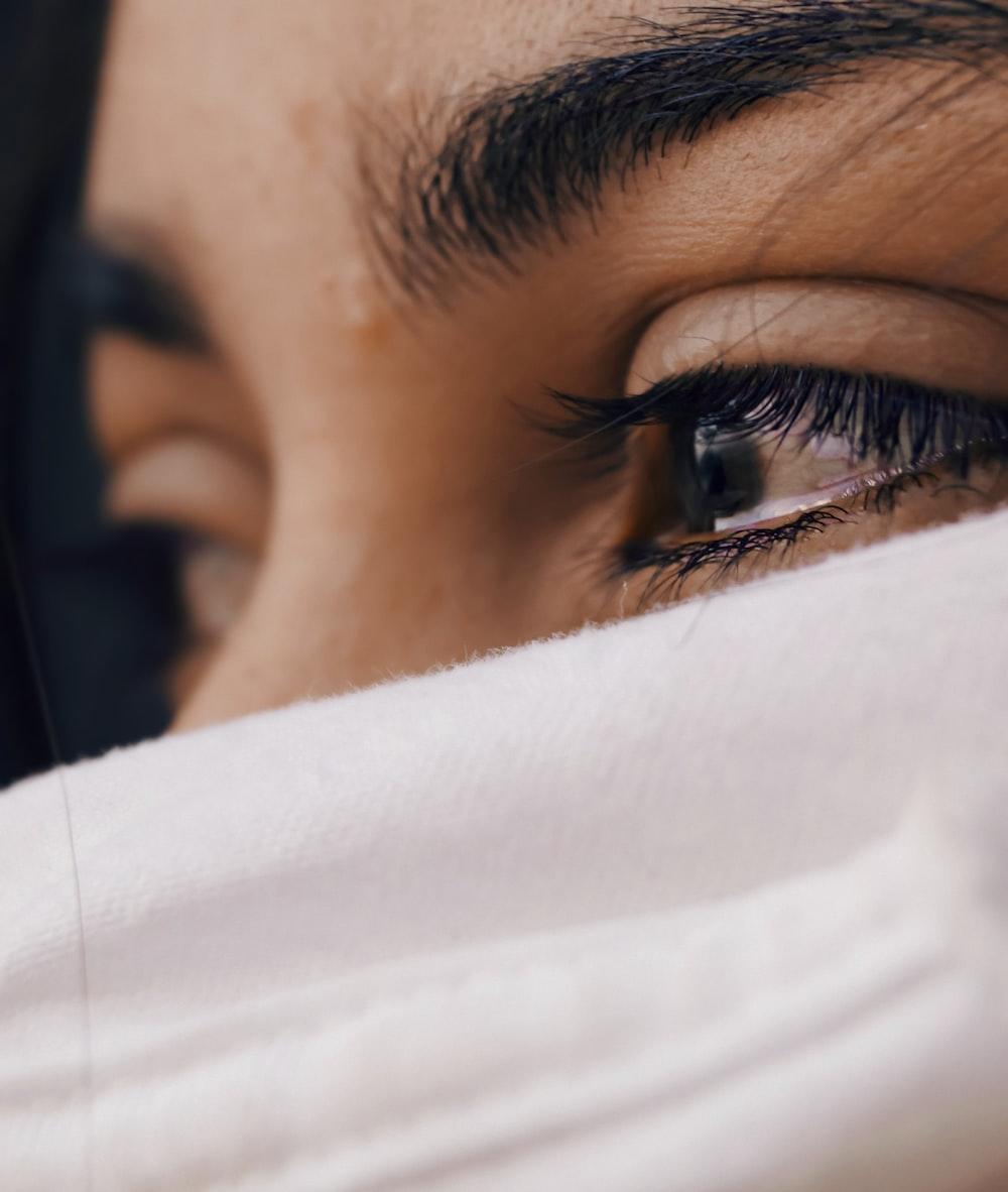 shallow focus of a woman's sad eyes