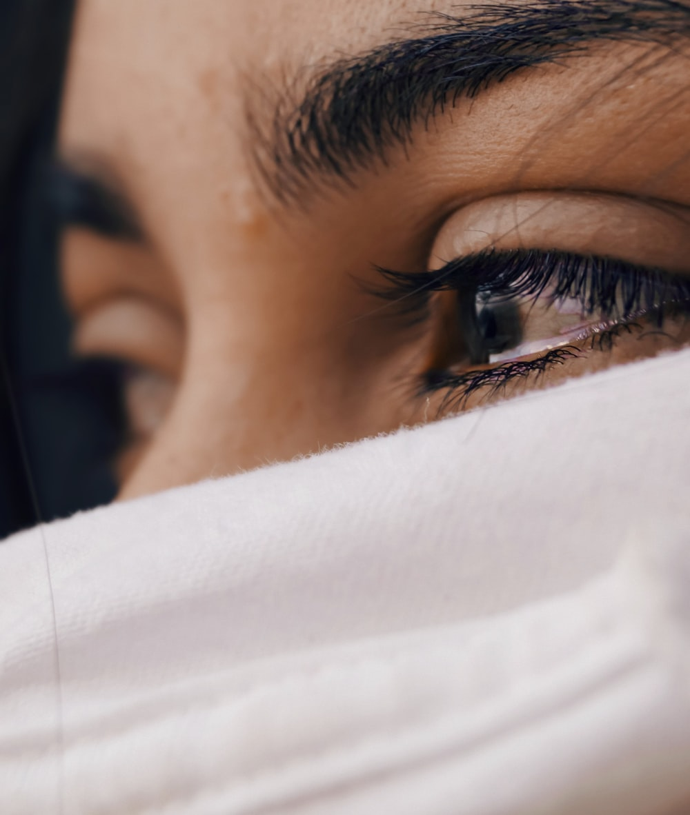 shallow focus photography of woman's eyes