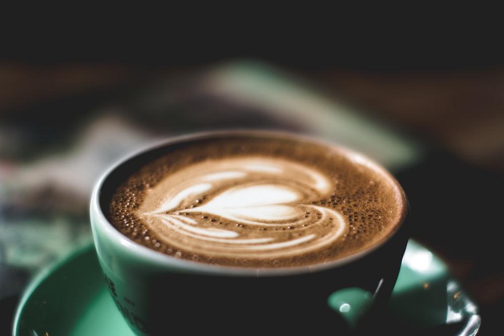 green ceramic mug filled with espresso