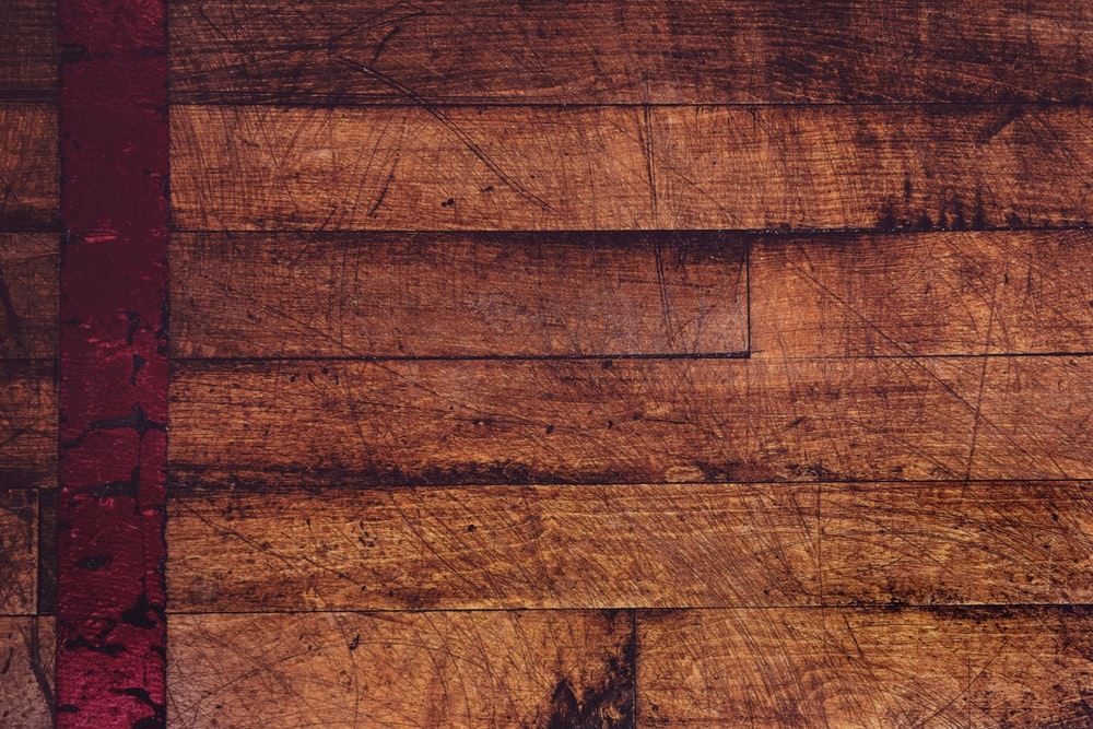 shallow focus photography of brown parquet flooring
