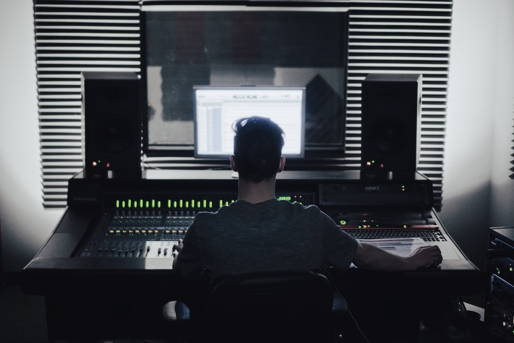man sitting in front of computer setup