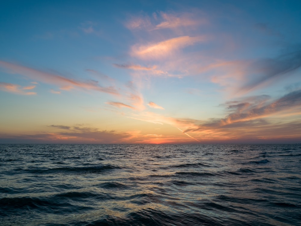 landscape photography of sea during golden hour