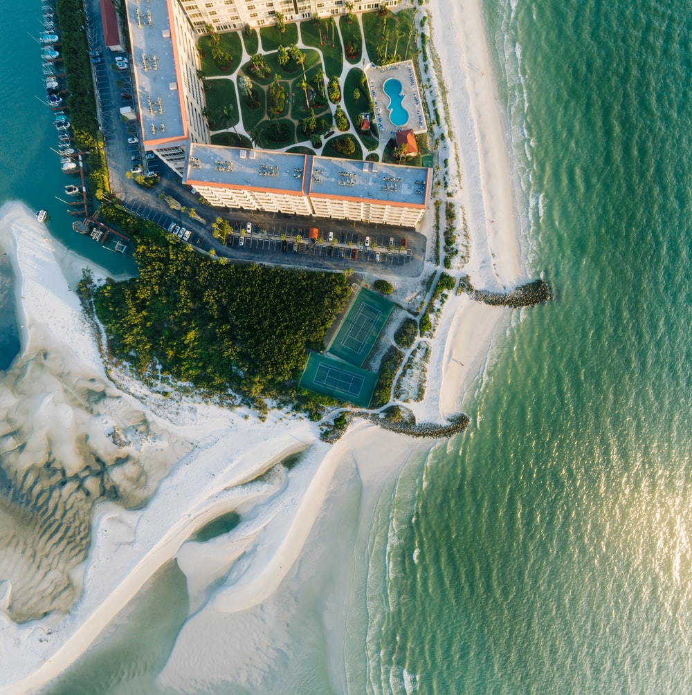 aerial photography of high rise building near ocean