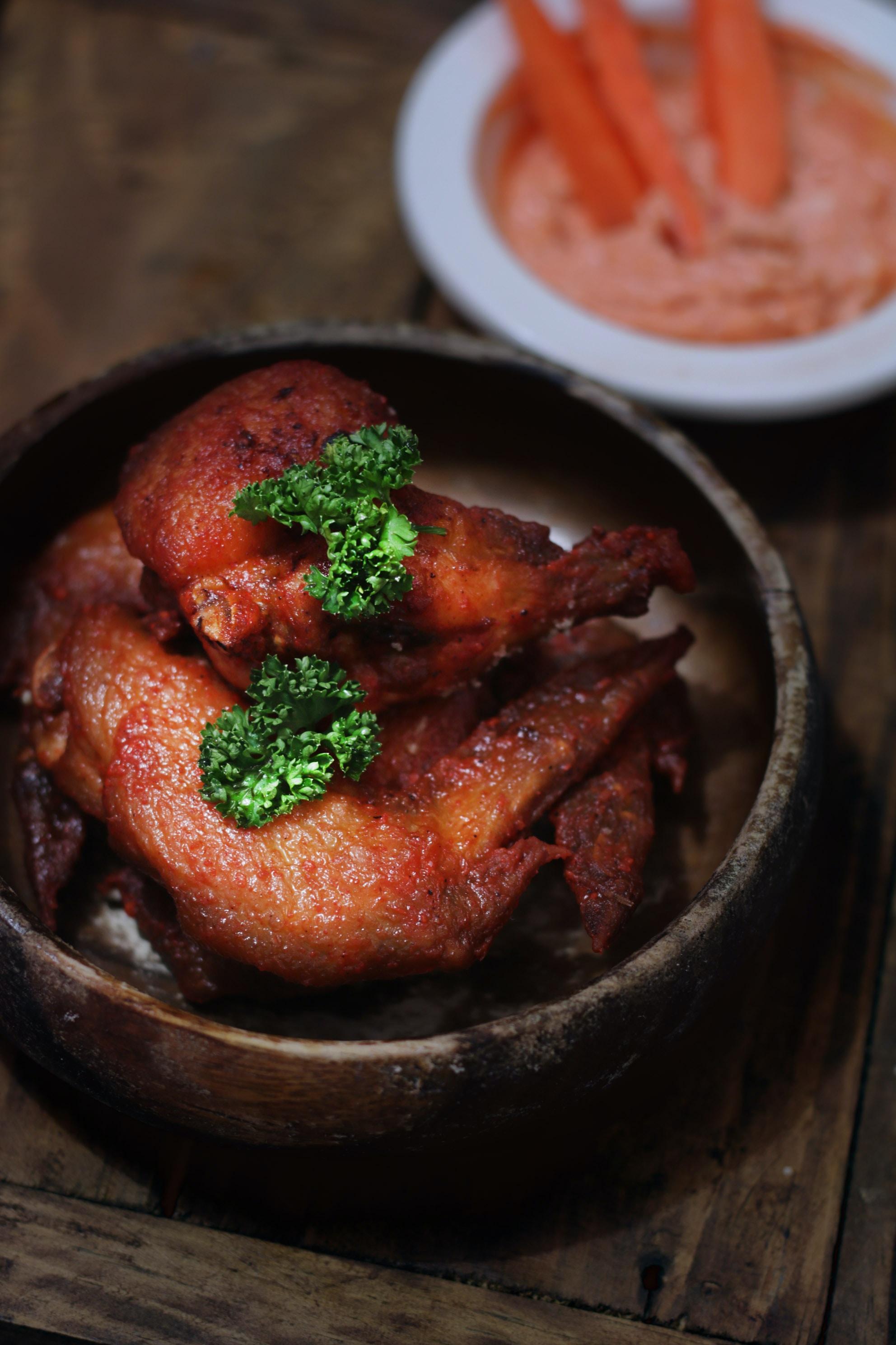 fried chicken in brown wooden bowl