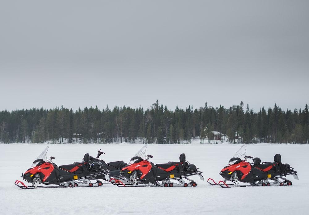 three snowblowers on snow covered field