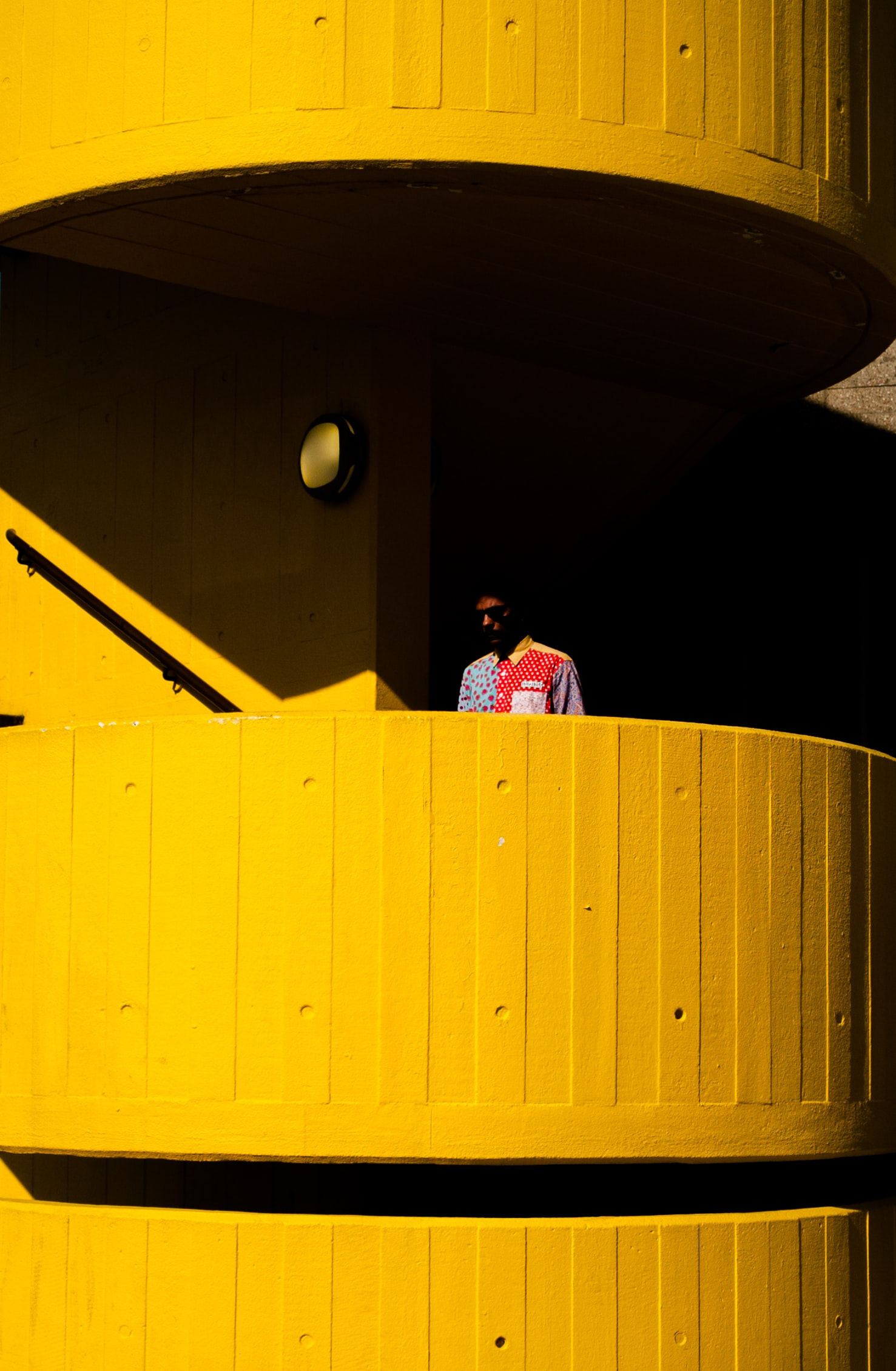 man near orange balcony